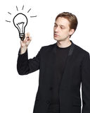 Man drawing a light bulb stock image