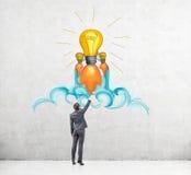 Man drawing light bulb sketch Stock Photo