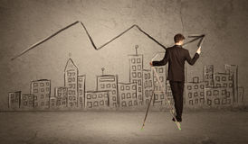 Man drawing line above the city Stock Images