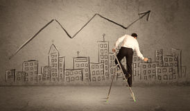 Man drawing line above the city Royalty Free Stock Image