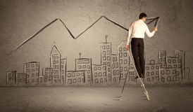 Man drawing line above the city Stock Image