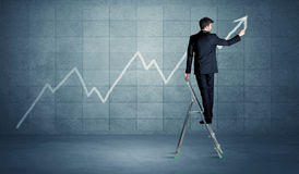 Man drawing line from ladder Stock Photos