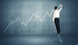 Man drawing line from ladder Royalty Free Stock Images