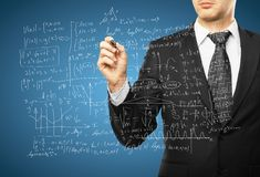 Man drawing mathematical formulas Stock Image