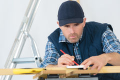 Man drawing and modifying house design Royalty Free Stock Images