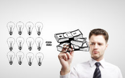Man drawing  money Royalty Free Stock Photography