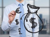 Man drawing money bag Stock Images