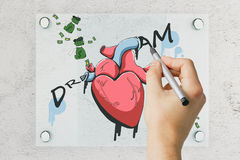 Man drawing money and heart sketch. Male hand drawing realistic heart, money sacks and dollar banknotes on white glass plate. 3D Rendering Stock Photos
