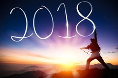 Man drawing 2018 on the mountain Stock Images
