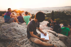 Man Drawing on Mountain Top Stock Photos