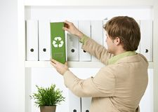 Man drawing out green folder Royalty Free Stock Image