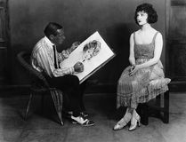 Man drawing portrait of woman. (All persons depicted are no longer living and no estate exists. Supplier grants that there will be no model release issues Stock Images