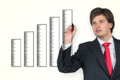 Man drawing ruler graph Royalty Free Stock Images