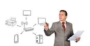 Man drawing scheme wi-fi. Businessman drawing scheme wi-fi  on white background Royalty Free Stock Images