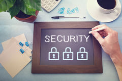 Man drawing security concept on chalkboard Royalty Free Stock Image