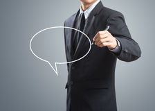 Man drawing sign speech bubble Royalty Free Stock Images