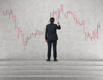 Man drawing stock chart. Businessman drawing color stock chart on wall Stock Photo