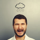 Man with drawing storm cloud Royalty Free Stock Photography