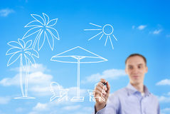 Man drawing a summer beach scene royalty free stock image