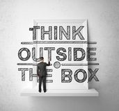Man drawing think outside the box Stock Image