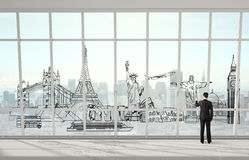 Man drawing traveling concept. On office window Stock Images