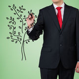 Man drawing tree Royalty Free Stock Images