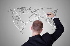 Man drawing a world map. On wall Stock Image