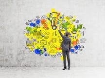 Man drawing yellow idea icons Stock Image
