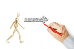Free Man Draws An Arrow And Shows The Way Where To Go Royalty Free Stock Photography - 84330567