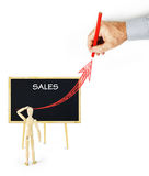 Man draws an arrow going up as a graph of future sales Royalty Free Stock Image