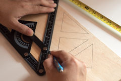 Man draws design, geometric shapes by pencil . Royalty Free Stock Photos