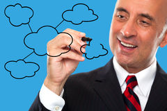 Man draws a diagram for cloud computing Royalty Free Stock Photo