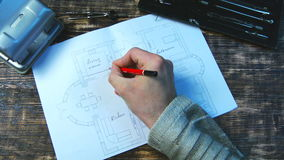 Man draws a draft. Indicates dimensions of rooms.  Royalty Free Stock Photography