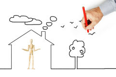 Man draws a house for other person. Conceptual image with pencil drawing royalty free stock photos