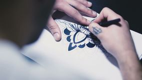 Man draws an image on paper stock footage