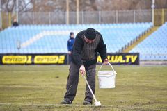 Man draws lines on the field Royalty Free Stock Photography