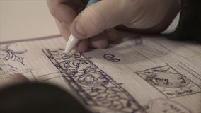 The man draws in a notebook,taking notes, the person writes in a diary, notebook. Writing Royalty Free Stock Photos