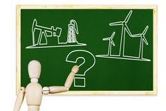 Man draws picture about renewable energy and oil production Royalty Free Stock Photos