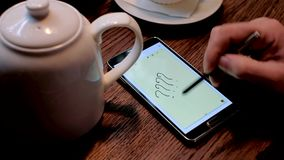 Man draws question marks on the smart phone screen stock footage