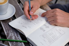 Man draws a sketch graphic design Stock Photo