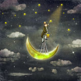 Man draws  stars  at top of tall ladder Royalty Free Stock Images