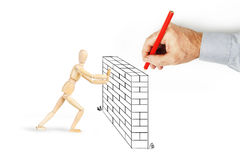 Man draws a wall and makes obstacles for other person Royalty Free Stock Photo