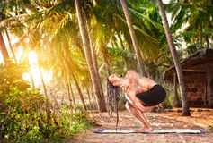 Man with dreadlocks doing yoga Stock Image