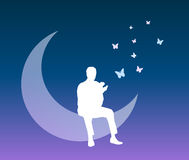 Man into a dream vector background. Vectored illustration as silhouette of a man sitting on the moon with butterflies flying from his hand, representing a dream Stock Photo