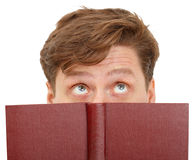 Man dreamily reading book - close-up of eyes Stock Image