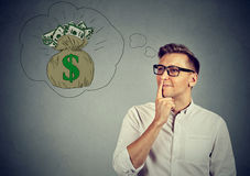 Man dreaming of financial success Stock Photography