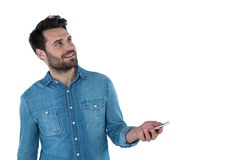 Man dreaming while holding a mobile phone Stock Photos