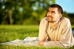 Man dreaming on a meadow Stock Photos