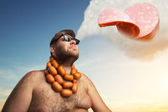 Man dreaming about sausages Stock Photography