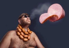 Man dreaming about sausages Stock Photos